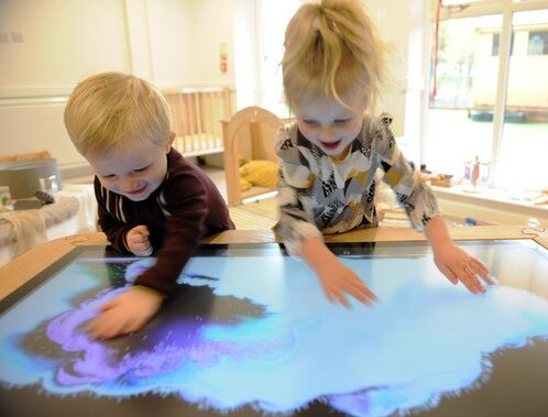 Children playing with A & A Digital Group interactive screens
